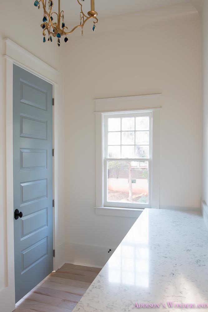 master-closet-dressing-room-alabaster-walls-vanity-bue-gray-door-chandelier-8-of-8