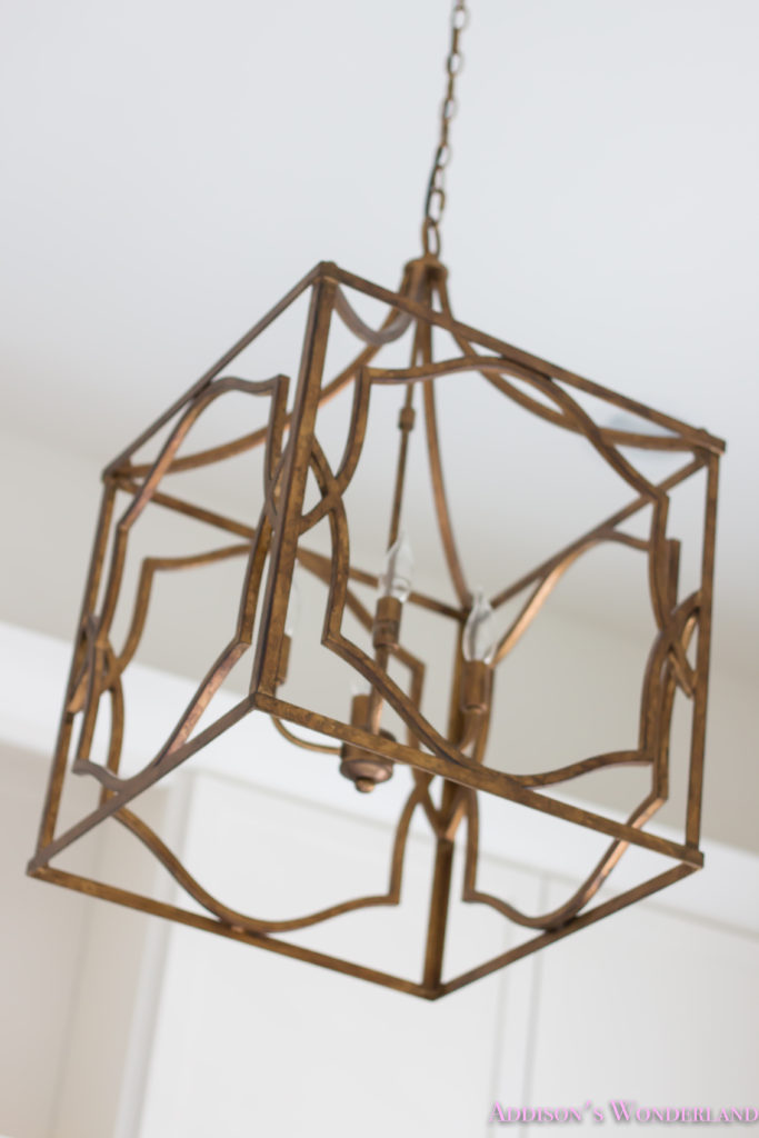 white-marble-porcelain-tile-shaw-floors-gold-lantern-chandelier-cement-tile-laundry-room-decor-1-of-7
