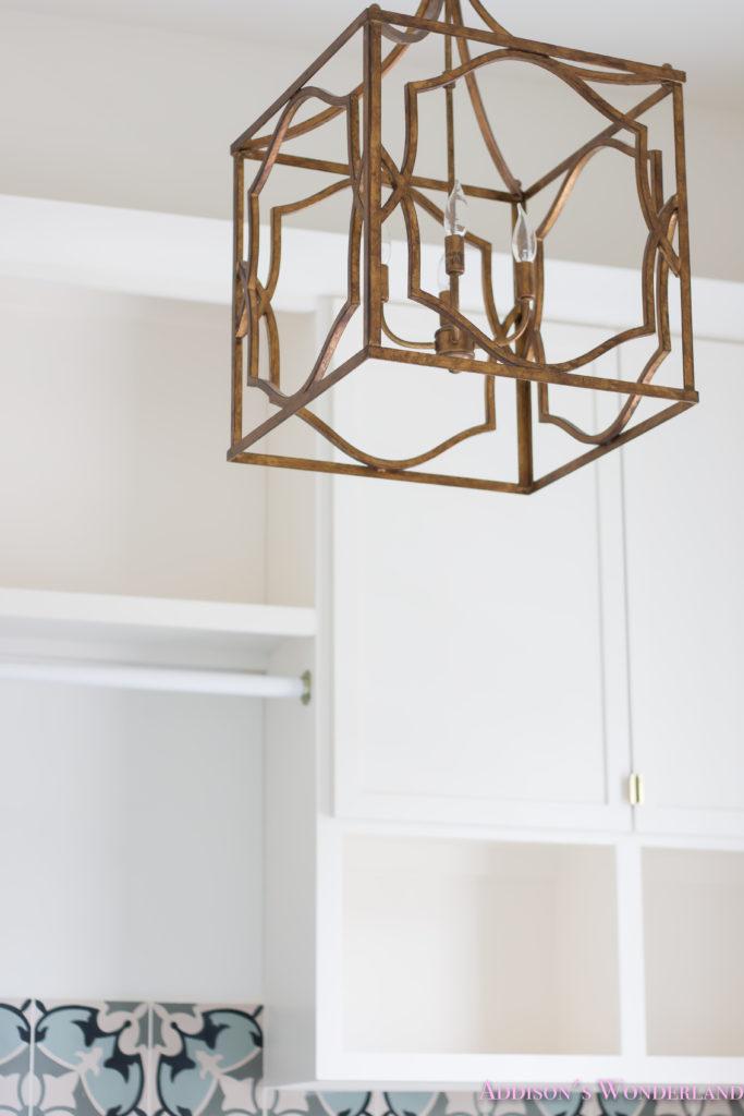white-marble-porcelain-tile-shaw-floors-gold-lantern-chandelier-cement-tile-laundry-room-decor-2-of-7