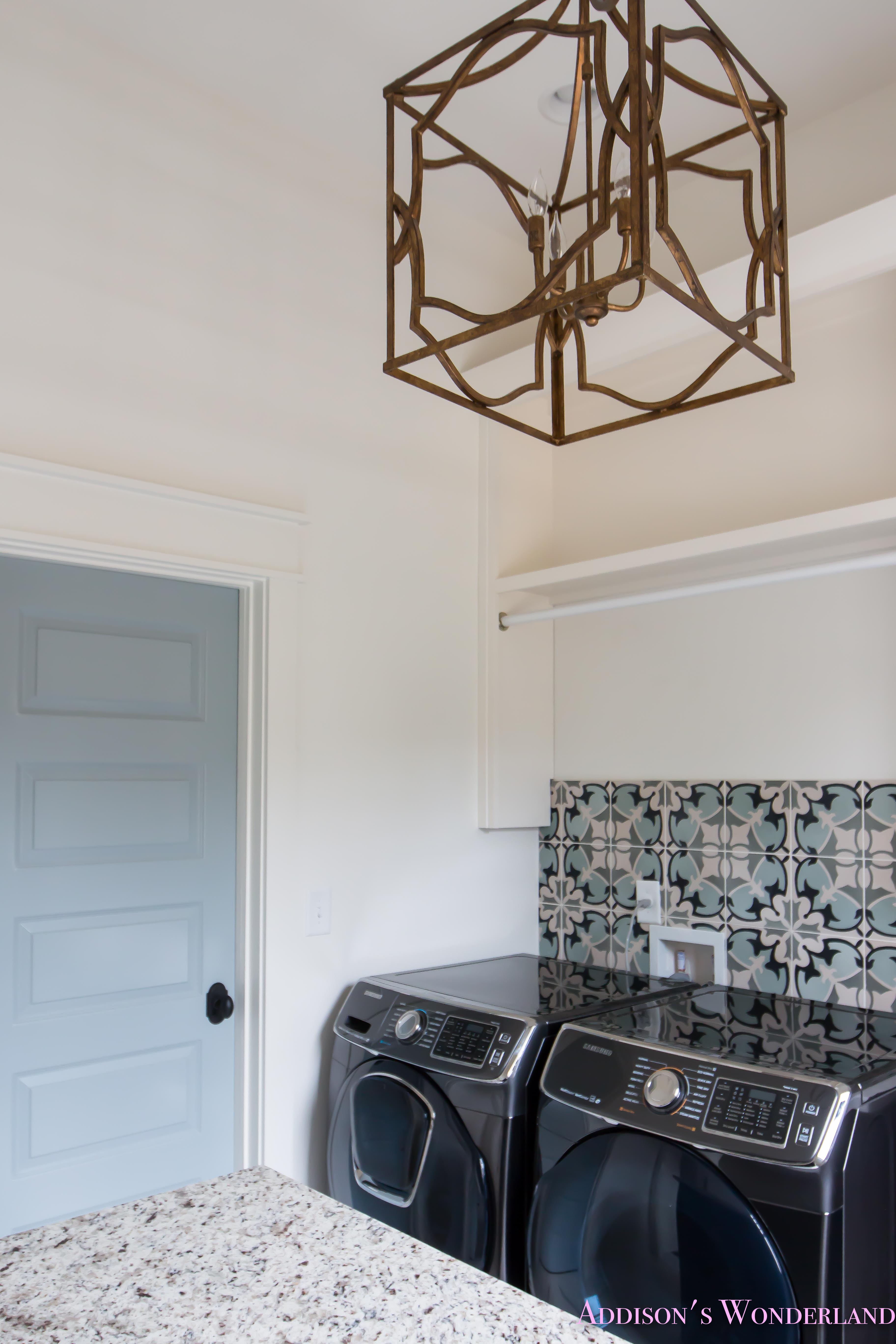 white-marble-porcelain-tile-shaw-floors-gold-lantern-chandelier