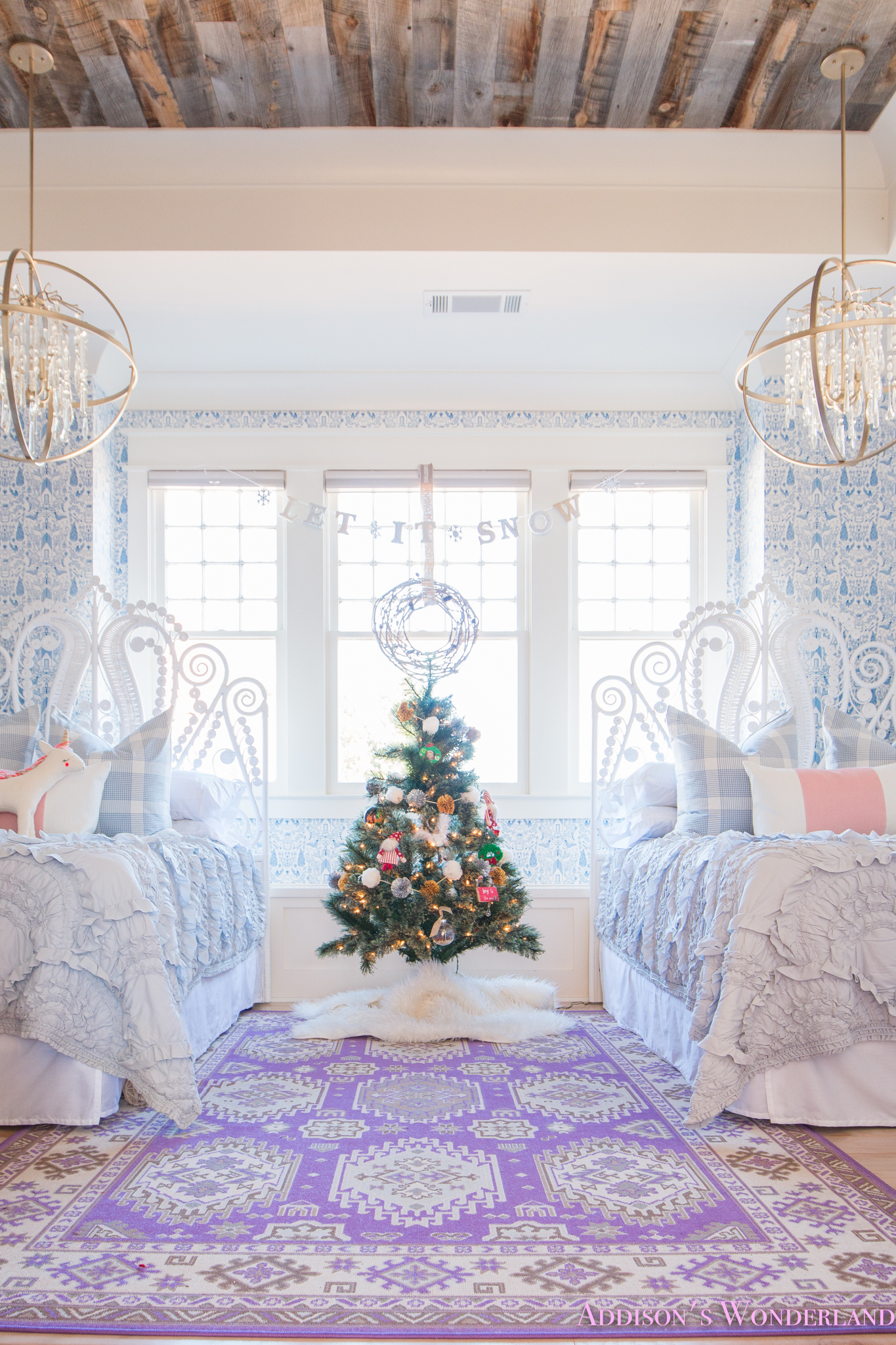 a blue and white little girls bedroom decked out for christmas
