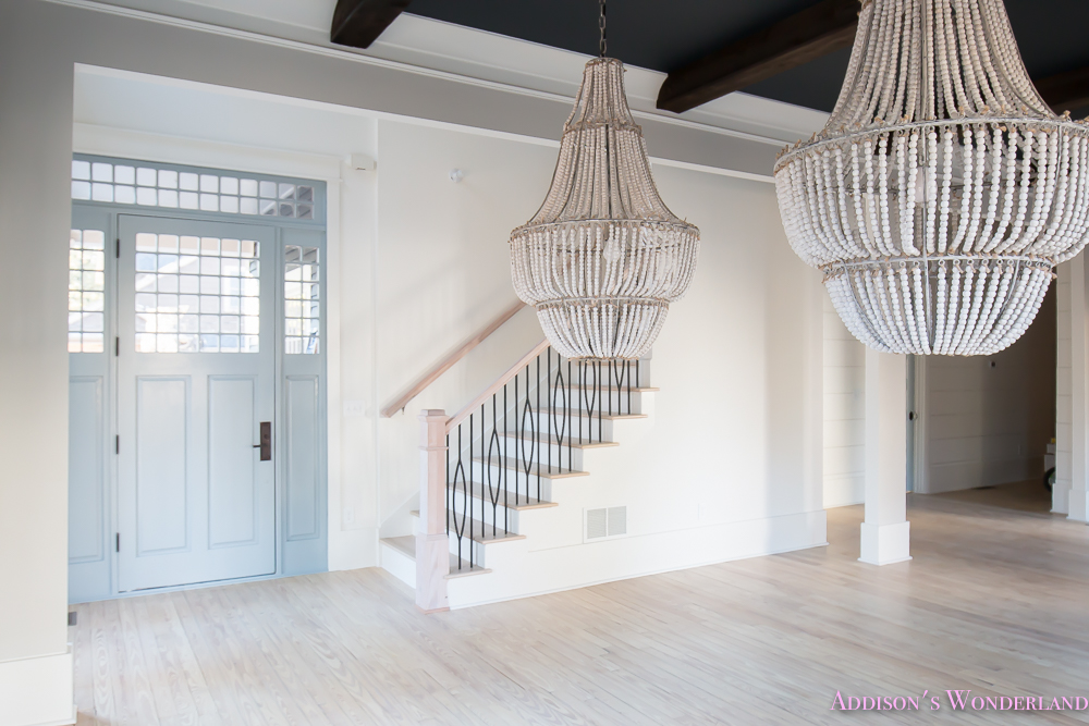 foyer-white-walls-blue-front-foor-uncertain-grey-stardew-alabaster-sherwin-williams-iron-baluster-staircase-whitewashed-hardwood-floors-3-of-5