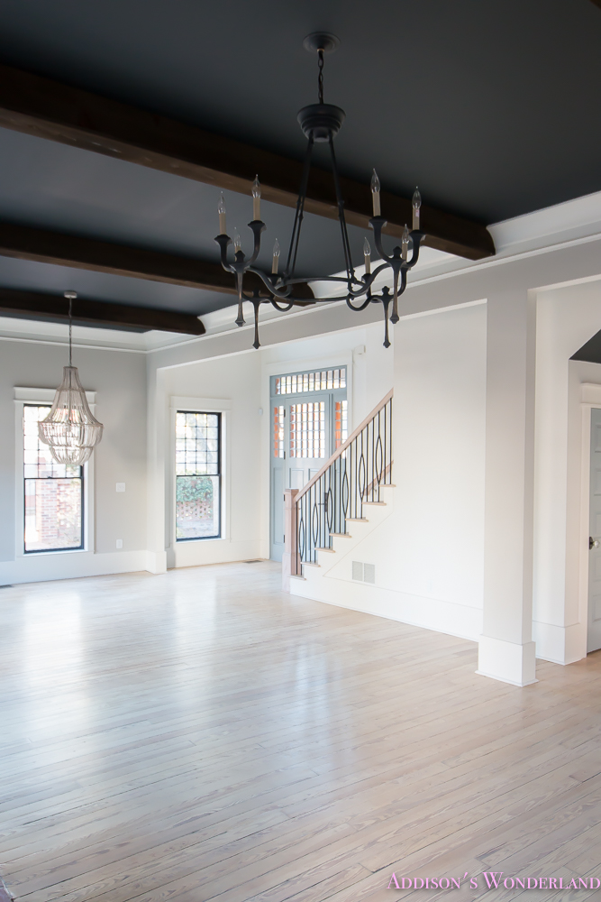 foyer-white-walls-blue-front-foor-uncertain-grey-stardew-alabaster-sherwin-williams-iron-baluster-staircase-whitewashed-hardwood-floors-5-of-5