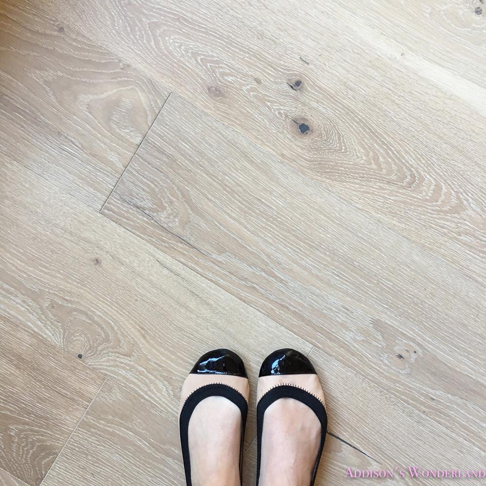 playroom-living-room-whitewashed-hardwood-floors-flooring-ceiling-rose-pink-doors-iron-baluster-staircase-white-walls-alabaster-sherwin-williams-1-of-1