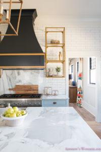 kitchen-white-marble-calcutta-gold-open-shelves-gold-black-vent-hood-blue-gray-cabinets-shaker-style-black-chevron-tile-subway-white-backsplash-decor-ideas-10-of-32