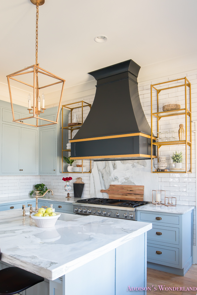 kitchen-white-marble-calcutta-gold-open-shelves-gold-black-vent-hood-blue-gray-cabinets-shaker-style-black-chevron-tile-subway-white-backsplash-decor-ideas-11-of-32
