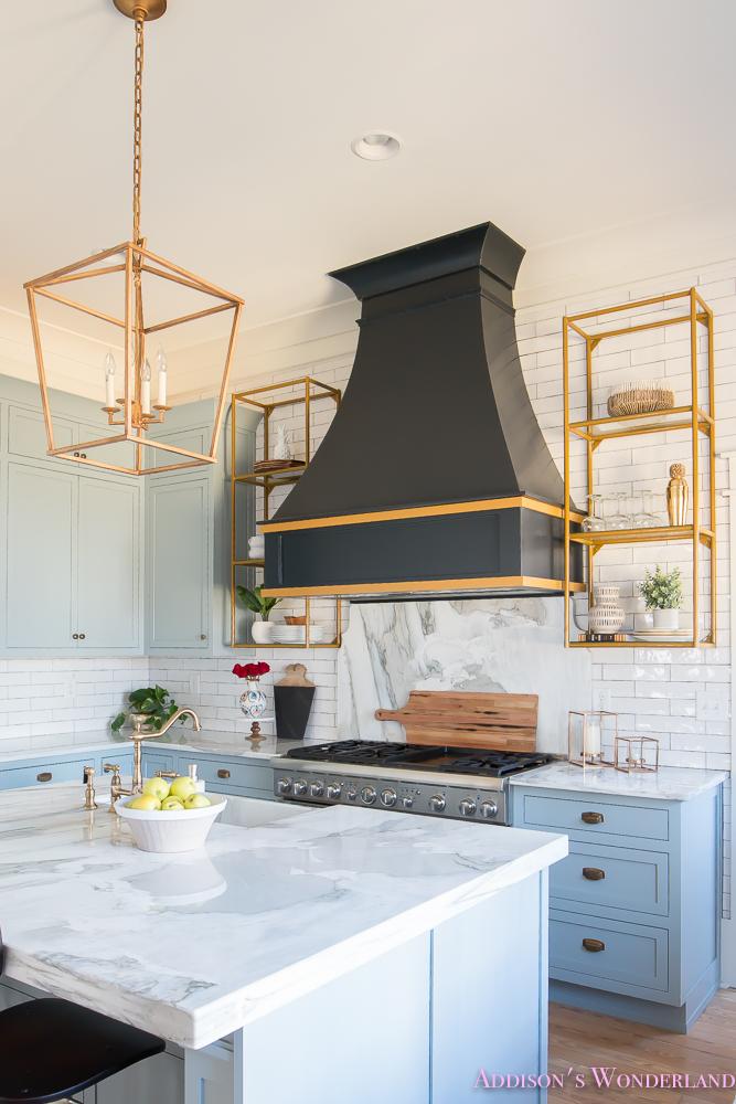 kitchen-white-marble-calcutta-gold-open-shelves-gold-black-vent-hood-blue-gray-cabinets-shaker-style-black-chevron-tile-subway-white-backsplash-decor-ideas-11-of-32