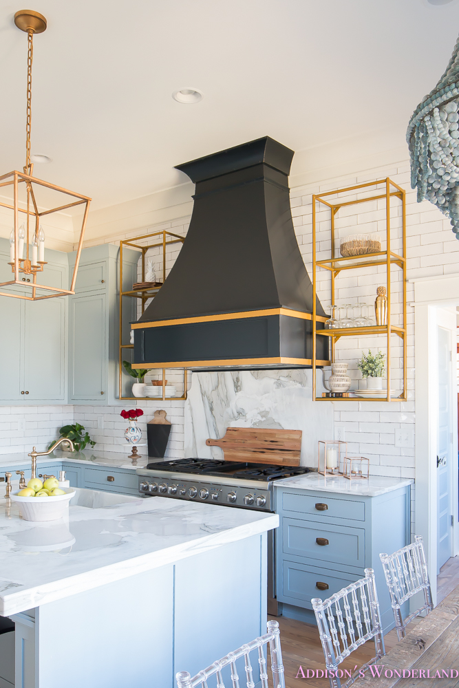 kitchen-white-marble-calcutta-gold-open-shelves-gold-black-vent-hood-blue-gray-cabinets-shaker-style-black-chevron-tile-subway-white-backsplash-decor-ideas-14-of-32