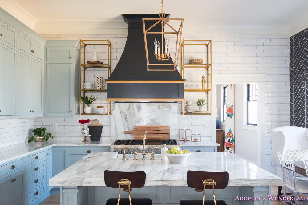kitchen-white-marble-calcutta-gold-open-shelves-gold-black-vent-hood-blue-gray-cabinets-shaker-style-black-chevron-tile-subway-white-backsplash-decor-ideas-15-of-32