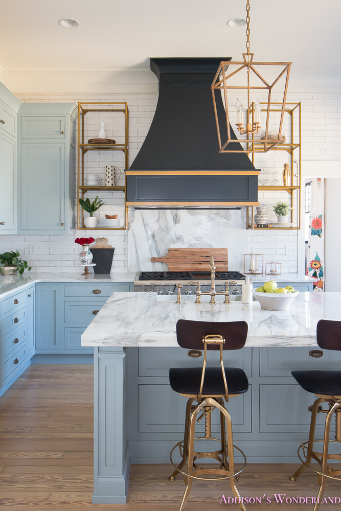 kitchen-white-marble-calcutta-gold-open-shelves-gold-black-vent-hood-blue-gray-cabinets-shaker-style-black-chevron-tile-subway-white-backsplash-decor-ideas-17-of-32