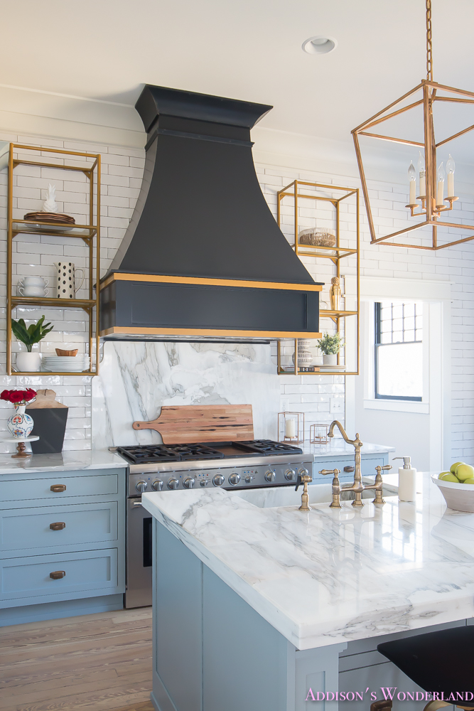 kitchen-white-marble-calcutta-gold-open-shelves-gold-black-vent-hood-blue-gray-cabinets-shaker-style-black-chevron-tile-subway-white-backsplash-decor-ideas-18-of-32