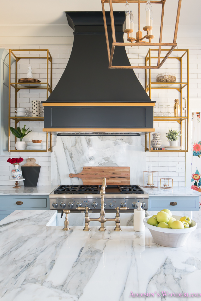 kitchen-white-marble-calcutta-gold-open-shelves-gold-black-vent-hood-blue-gray-cabinets-shaker-style-black-chevron-tile-subway-white-backsplash-decor-ideas-19-of-32