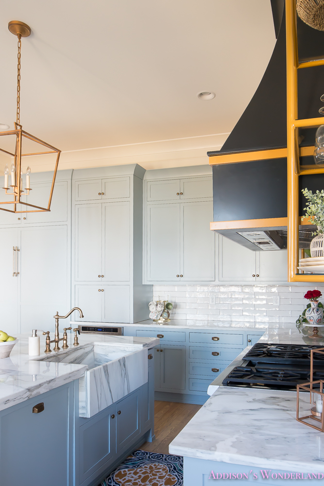 kitchen-white-marble-calcutta-gold-open-shelves-gold-black-vent-hood-blue-gray-cabinets-shaker-style-black-chevron-tile-subway-white-backsplash-decor-ideas-20-of-32