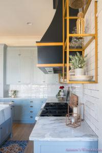 kitchen-white-marble-calcutta-gold-open-shelves-gold-black-vent-hood-blue-gray-cabinets-shaker-style-black-chevron-tile-subway-white-backsplash-decor-ideas-22-of-32