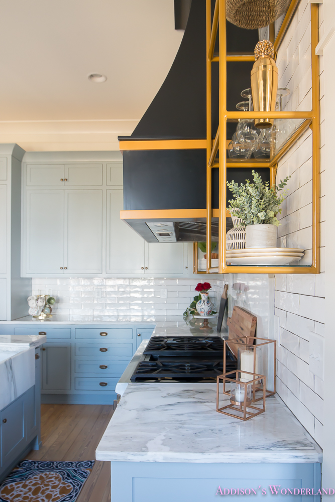 kitchen-white-marble-calcutta-gold-open-shelves-gold-black-vent-hood-blue-gray-cabinets-shaker-style-black-chevron-tile-subway-white-backsplash-decor-ideas-22-of-32