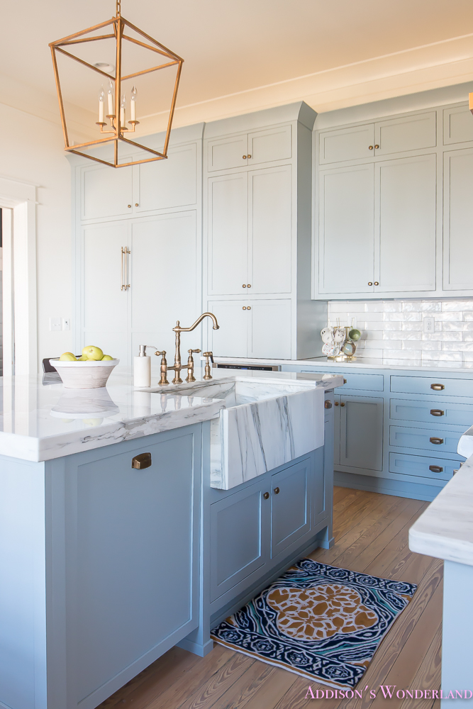 kitchen-white-marble-calcutta-gold-open-shelves-gold-black-vent-hood-blue-gray-cabinets-shaker-style-black-chevron-tile-subway-white-backsplash-decor-ideas-23-of-32