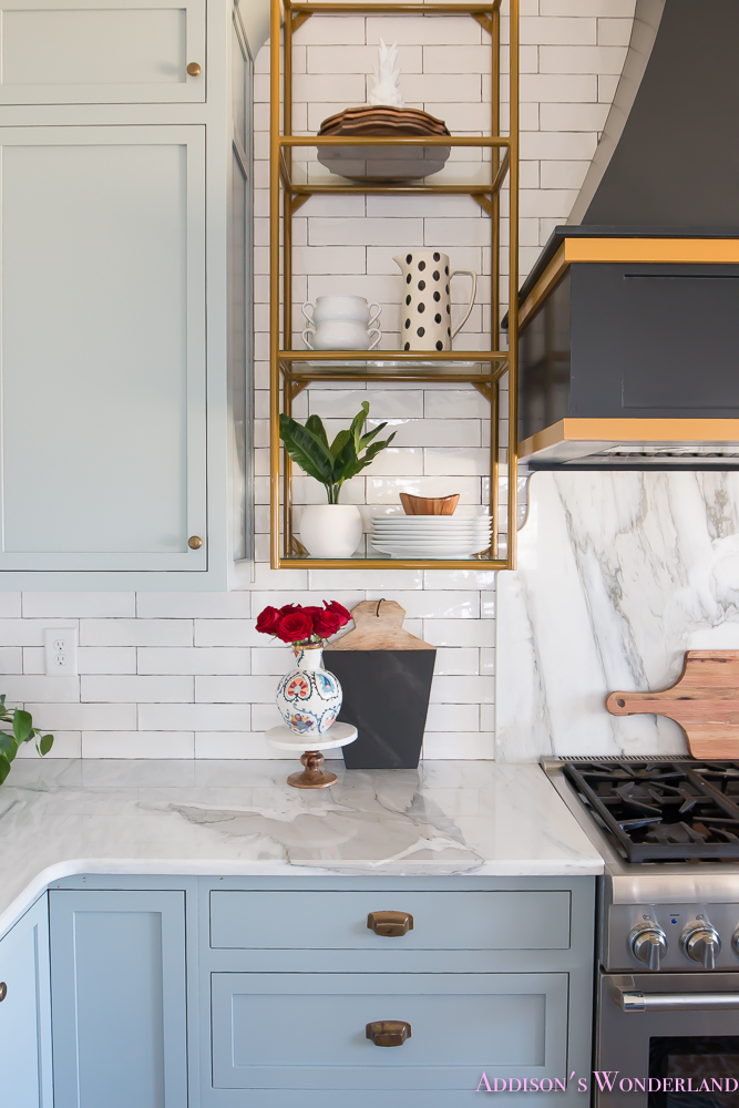 kitchen-white-marble-calcutta-gold-open-shelves-gold-black-vent-hood-blue-gray-cabinets-shaker-style-black-chevron-tile-subway-white-backsplash-decor-ideas-25-of-32