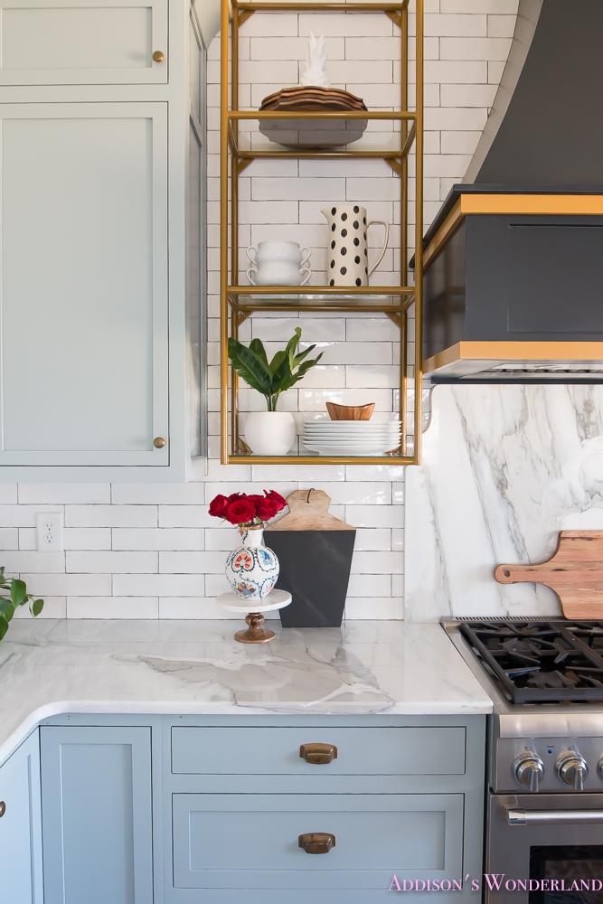 kitchen-white-marble-calcutta-gold-open-shelves-gold-black-vent-hood-blue-gray-cabinets-shaker-style-black-chevron-tile-subway-white-backsplash-decor-ideas-25-of-32