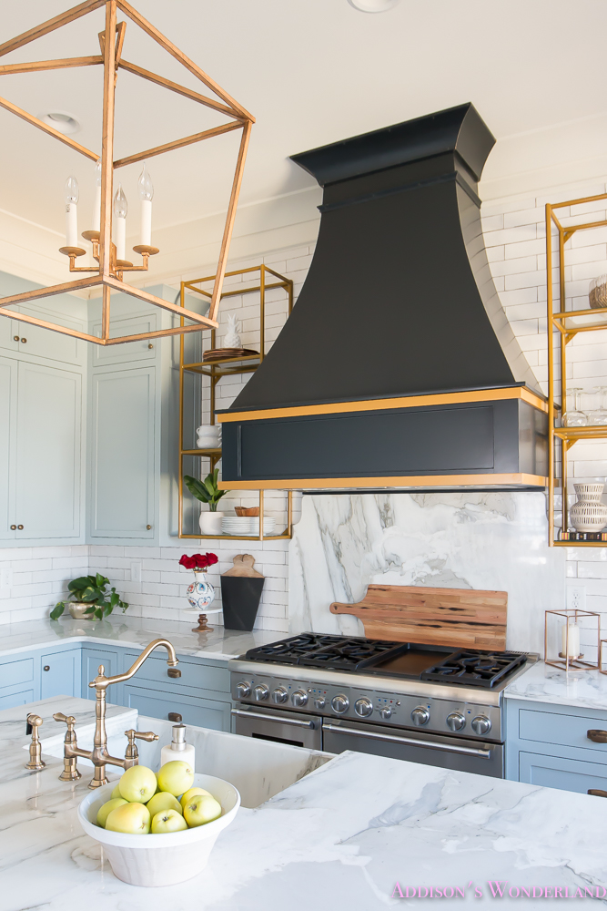 Kitchen White Marble Calcutta Gold Open Shelves Gold Black Vent Hood Blue Gray Cabinets Shaker