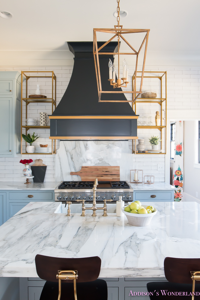 kitchen-white-marble-calcutta-gold-open-shelves-gold-black-vent-hood-blue-gray-cabinets-shaker-style-black-chevron-tile-subway-white-backsplash-decor-ideas-27-of-32