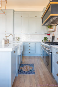 kitchen-white-marble-calcutta-gold-open-shelves-gold-black-vent-hood-blue-gray-cabinets-shaker-style-black-chevron-tile-subway-white-backsplash-decor-ideas-28-of-32