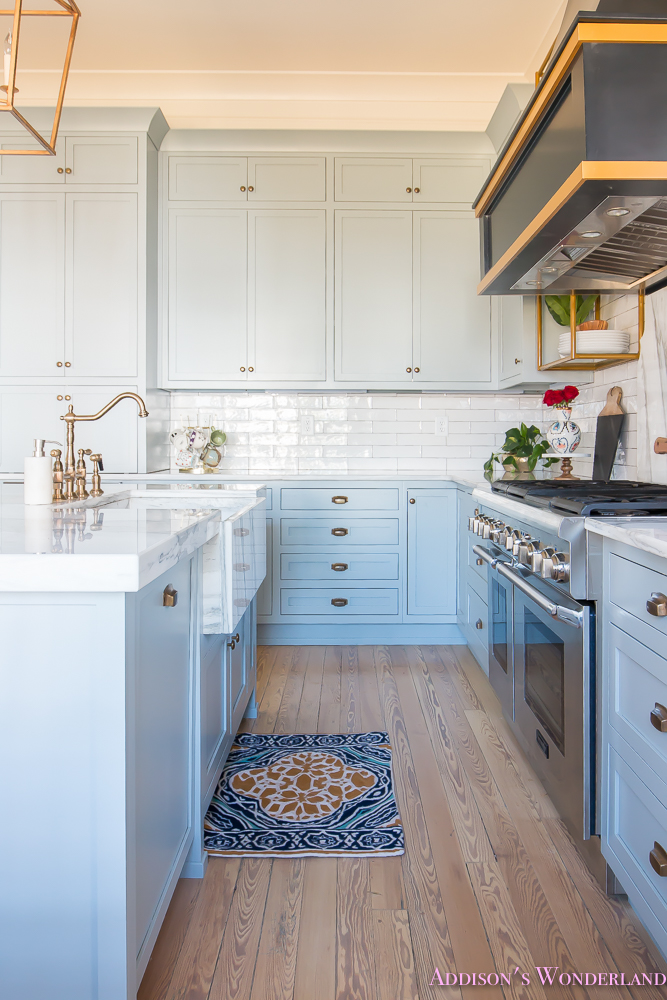 kitchen-white-marble-calcutta-gold-open-shelves-gold-black-vent-hood-blue-gray-cabinets-shaker-style-black-chevron-tile-subway-white-backsplash-decor-ideas-28-of-32