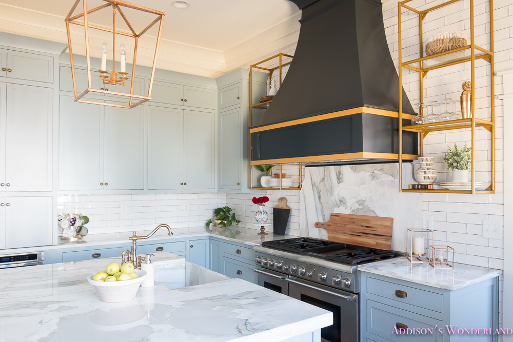 kitchen-white-marble-calcutta-gold-open-shelves-gold-black-vent-hood-blue-gray-cabinets-shaker-style-black-chevron-tile-subway-white-backsplash-decor-ideas-29-of-32