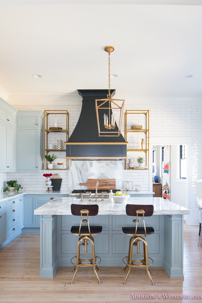 kitchen-white-marble-calcutta-gold-open-shelves-gold-black-vent-hood-blue-gray-cabinets-shaker-style-black-chevron-tile-subway-white-backsplash-decor-ideas-3-of-32