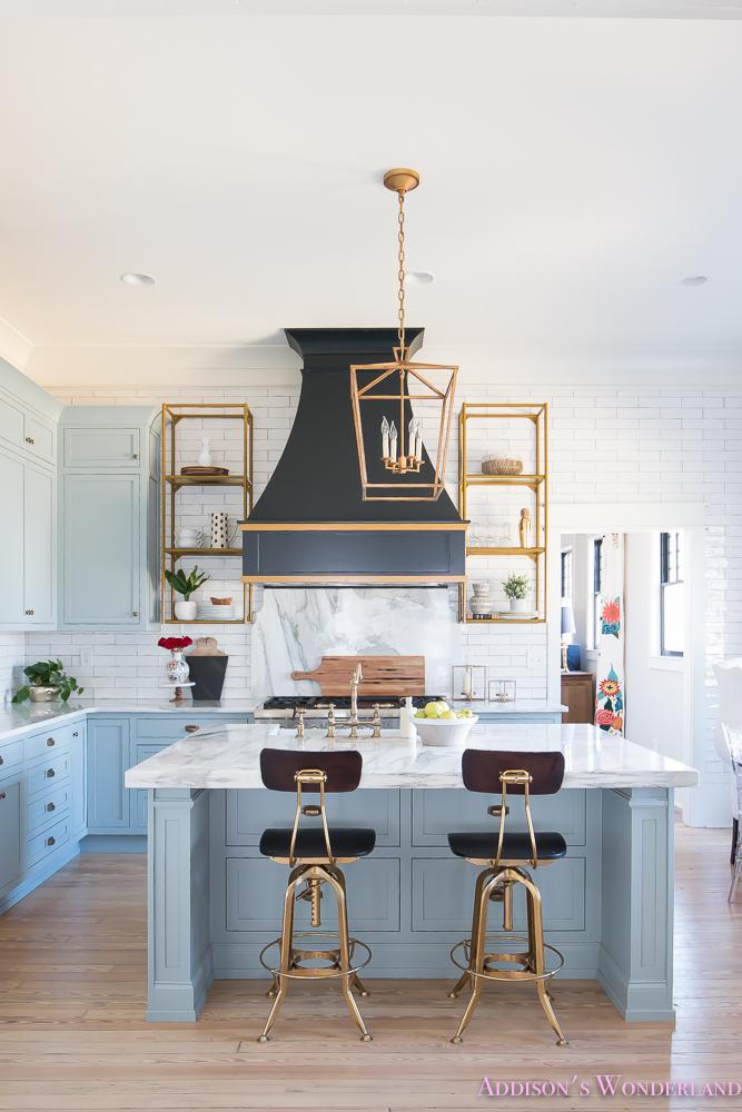 kitchen-white-marble-calcutta-gold-open-shelves-gold-black-vent-hood-blue-gray-cabinets-shaker-style-black-chevron-tile-subway-white-backsplash-decor-ideas-3-of-32