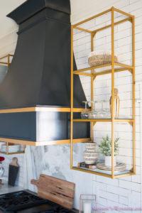 kitchen-white-marble-calcutta-gold-open-shelves-gold-black-vent-hood-blue-gray-cabinets-shaker-style-black-chevron-tile-subway-white-backsplash-decor-ideas-30-of-32