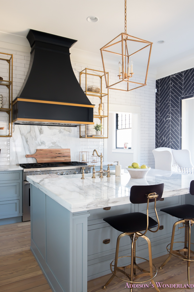 kitchen-white-marble-calcutta-gold-open-shelves-gold-black-vent-hood-blue-gray-cabinets-shaker-style-black-chevron-tile-subway-white-backsplash-decor-ideas-32-of-32