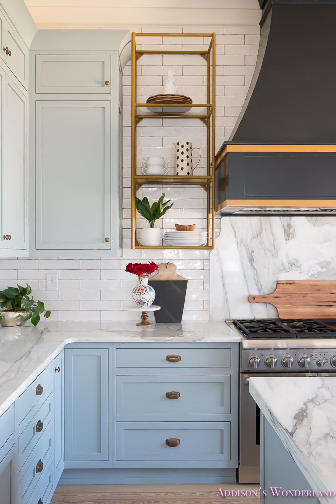 kitchen-white-marble-calcutta-gold-open-shelves-gold-black-vent-hood-blue-gray-cabinets-shaker-style-black-chevron-tile-subway-white-backsplash-decor-ideas-8-of-32
