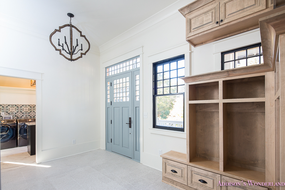 mud-room-white-penny-tile-mosaic-shaw-floors-blue-front-door-alabaster-sherwin-williams-cabinets-coat-rack-storage-1-of-3