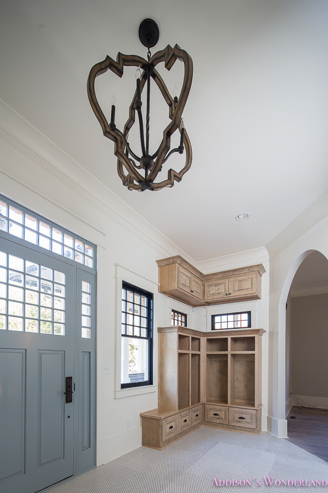 mud-room-white-penny-tile-mosaic-shaw-floors-blue-front-door-alabaster-sherwin-williams-cabinets-coat-rack-storage-3-of-3